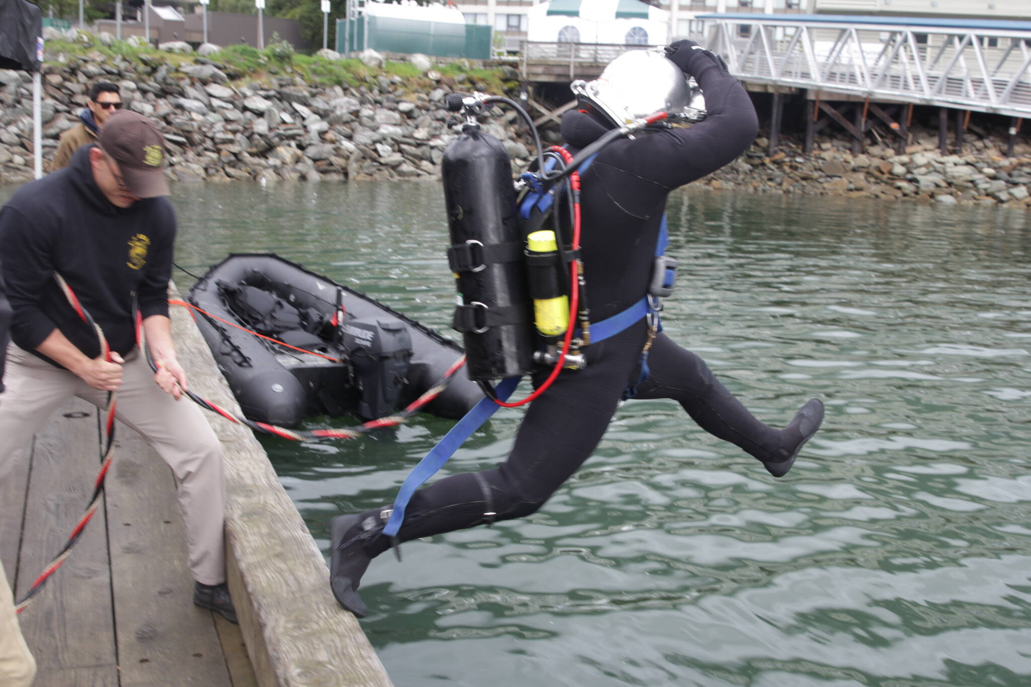 Army Pfc. Luke McCarty jumps in the water during training for the engineer divers with a Coast Guard dive team on Sept. 6, 2021. (Courtesy photo / MyKenzie Robertson)