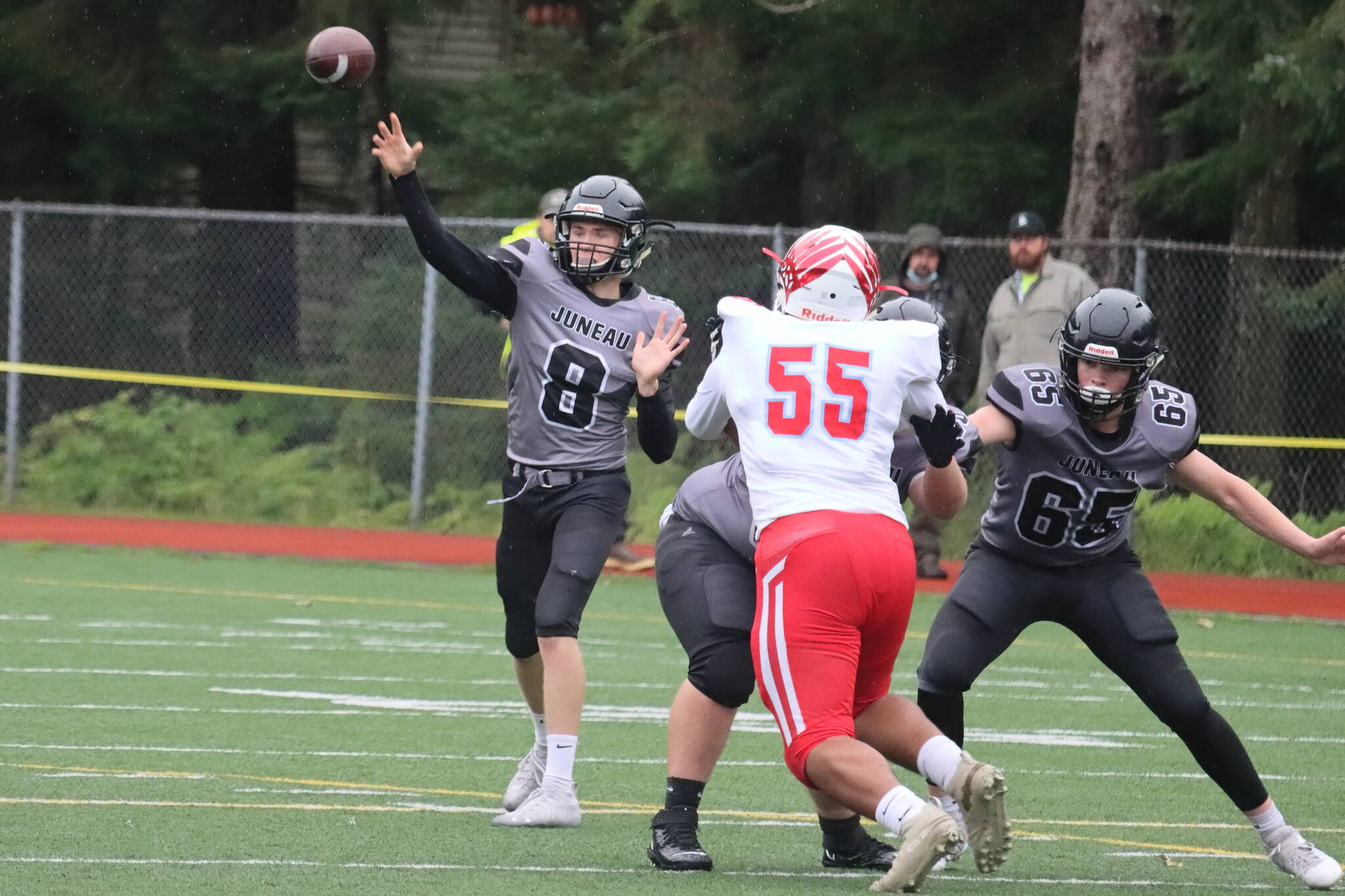 Noah Chambers throws the ball during a game against East Anchorage High School on Sept. 4, 2021. Chambers turned in another solid performance last week as the Huskies beat Service High School in an away game. (Ben Hohenstatt / Juneau Empire File)