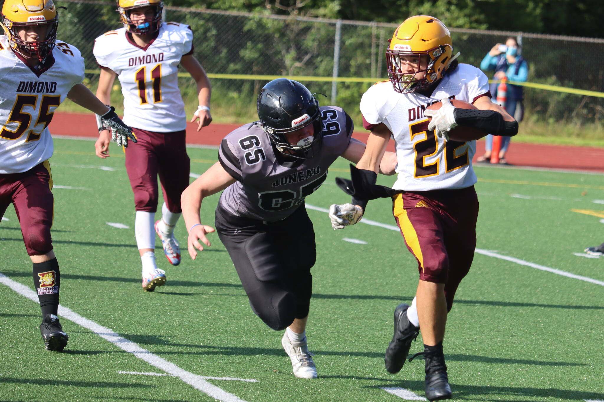 Brandon Campbell chases down a Dimond ball carrier during an Aug. 21 game. The Juneau Huskies and Dimond Lynx will face off again on Saturday. (Ben Hohenstatt / Juneau Empire File)